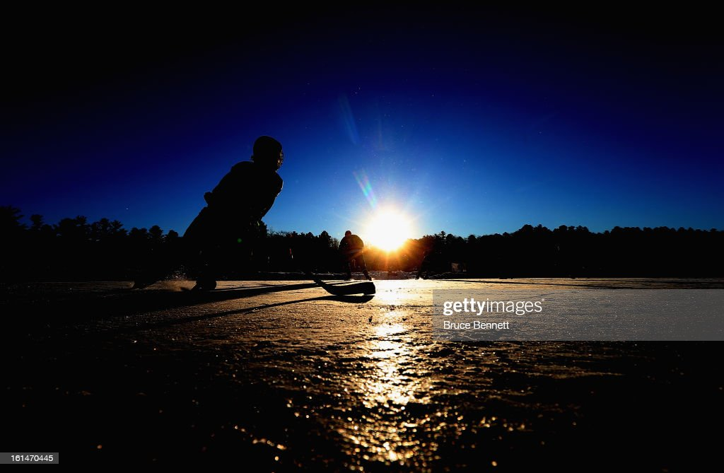 A player participates in the 2013 USA Hockey Pond Hockey National Championships on February 8, 2013 in Eagle River, Wisconsin. The three-day tournament features 2,400 participants from 30 states playing a round robin tournament on 28 rinks laid out on Dollar Lake.