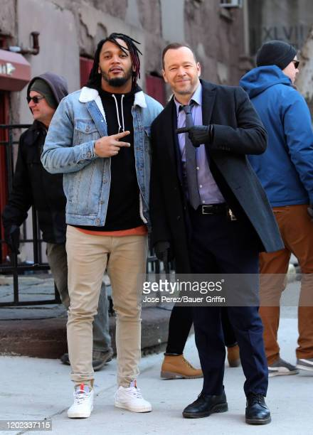 Player Patrick Chung and Donnie Wahlberg are seen on set of 'Blue Bloods' on February 21, 2020 in New York City.