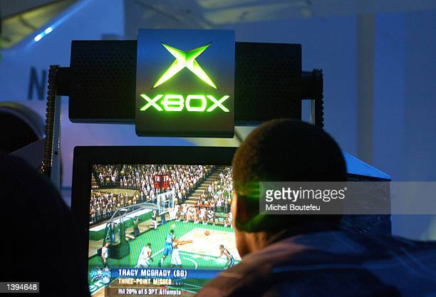 NBA player Paul Pierce plays Microsoft Game Studios' new video game NBA Inside Drive 2003 September 18 2002 in TWC Aviation Hangar in Burbank...