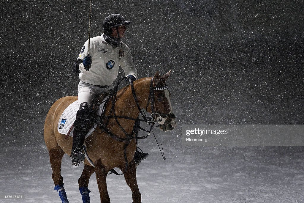 A player pauses in the snow at the annual Klosters Snow Polo event in Klosters, Switzerland, on Friday, Jan. 20, 2012. German Chancellor Angela Merkel will open next week's World Economic Forum in Davos, Switzerland, which will be attended by policy makers and business leaders including U.S. Treasury Secretary Timothy F. Geithner. Photographer: Scott Eells/Bloomberg via Getty Images