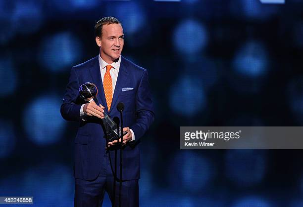 NFL player Peyton Manning of the Denver Broncos accepts the Best RecordBreaking Performance award onstage during the 2014 ESPYS at Nokia Theatre LA...
