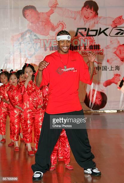 NBA player Philadelphia 76ers guard Allen Iverson plays games with orphans at Shanghai Children's Welfare Center on September 24 2005 in Shanghai...