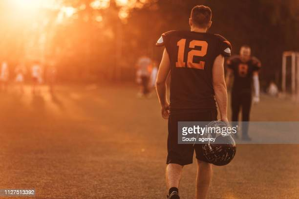 nfl player - football league stock pictures, royalty-free photos & images