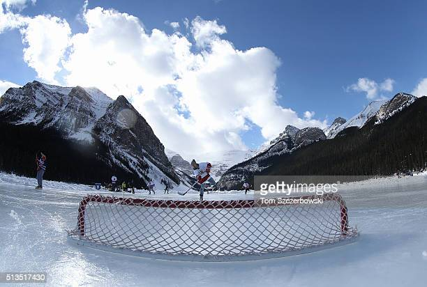A player practices on an outdoor shinny hockey rink before the start of the next tournament game during the 7th Annual Lake Louise Pond Hockey...
