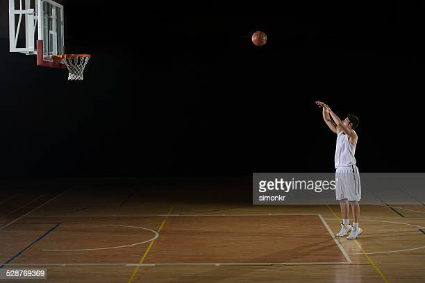 player practicing a free throw - shooting baskets stock photos and pictures