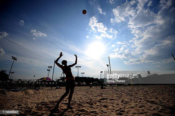 Player prepares for round robin competitions of the Main Draw in the 2011 FIVB Beach Volleyball Swatch World Tour Beijing Grand Slam at the Chaoyang...