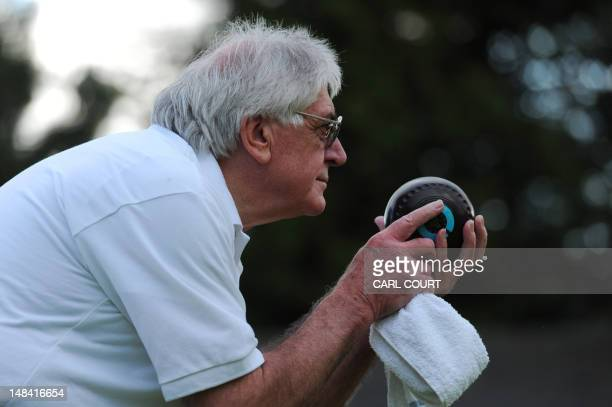 A player prepares to bowl during a game of bowls at Finchley Bowling Club in north London on July 6 2012 At the same time as athletes from around the...