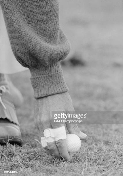 A player puts his ball on a tee peg during the 1967 Open Championship at Royal Liverpool Golf Club Hoylake England