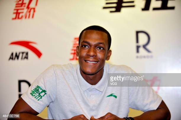 NBA player Rajon Rondo of the Boston Celtics attends a press conference at an Anta Store on August 25 2014 in Beijing China