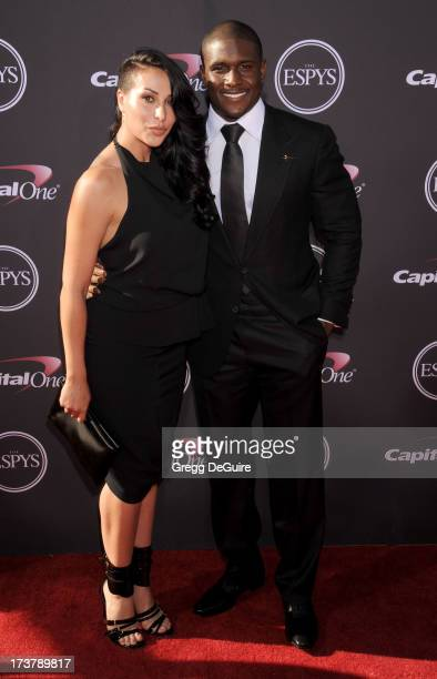 NFL player Reggie Bush and girlfriend Lilit Avagyan arrive at the 2013 ESPY Awards at Nokia Theatre LA Live on July 17 2013 in Los Angeles California