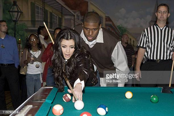 Player Reggie Bush of the New Orleans Saints helps Kim Kardashian with her pool shots at the 2008 NBA All-Star Shaquille O'Neal and Reggie Bush...