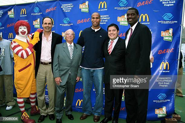 NBA player Richard Jefferson of the New Jersey Nets and NBA legend Albert King attend a new basketball court ribbon cutting ceremony at Jersey City...