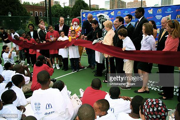 NBA player Richard Jefferson of the New Jersey Nets cuts ribbon at a new basketball court ribbon cutting ceremony at Jersey City Boys Girls Club...