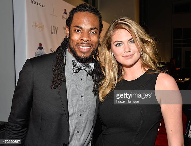 Player Richard Sherman and model Kate Upton attends Club SI Swimsuit at LIV Nightclub hosted by Sports Illustrated at Fontainebleau Miami on February...