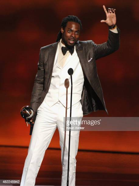 NFL player Richard Sherman of the Seattle Seahawks accepts the Best Breakthrough Athlete award onstage during the 2014 ESPYS at Nokia Theatre LA Live...