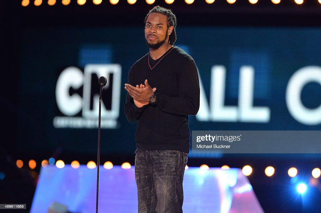 NFL player Richard Sherman of the Seattle Seahawks speaks onstage during Cartoon Network's fourth annual Hall of Game Awards at Barker Hangar on February 15, 2014 in Santa Monica, California.