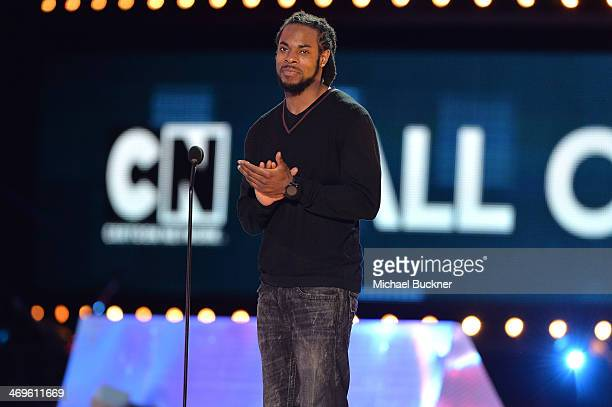 NFL player Richard Sherman of the Seattle Seahawks speaks onstage during Cartoon Network's fourth annual Hall of Game Awards at Barker Hangar on...