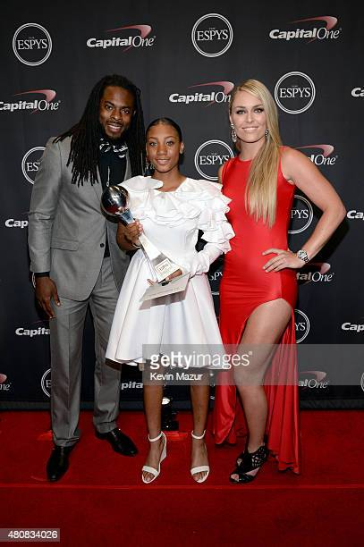 NFL player Richard Sherman with athlete Mo'ne Davis and skiier Lindsey Vonn with award for Best Breakthrough Athlete at The 2015 ESPYS at Microsoft...