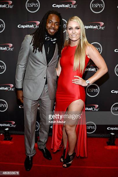 NFL player Richard Sherman with Skiier Lindsey Vonn attend The 2015 ESPYS at Microsoft Theater on July 15 2015 in Los Angeles California