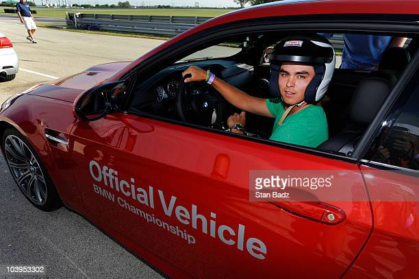 TOUR player Rickie Fowler prepares to head out for a BMW vehicle test drive at the Autobahn Country Club Racetrack on September 9 2010 in Joliet...