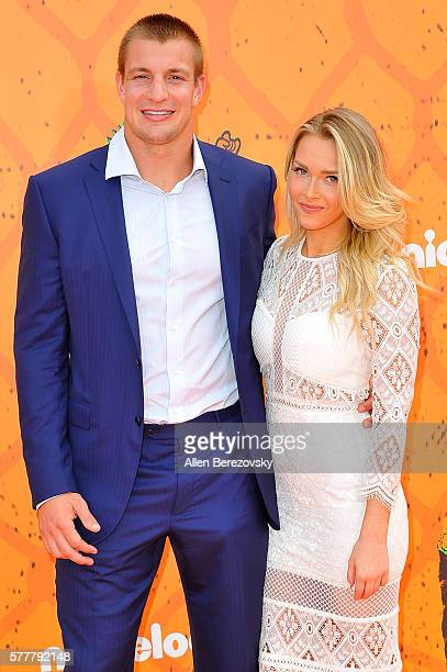 NFL player Rob Gronkowski and girlfriend Camille Kostek arrive at the Nickelodeon Kids' Choice Sports Awards 2016 at UCLA's Pauley Pavilion on July...