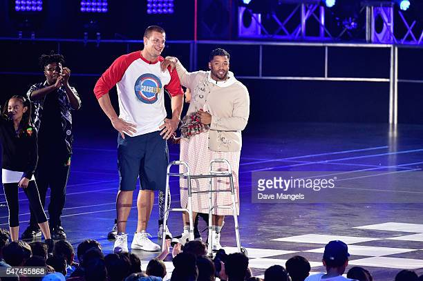 Player Rob Gronkowski and host Russell Wilson speak onstage during the Nickelodeon Kids' Choice Sports Awards 2016 at UCLA's Pauley Pavilion on July...