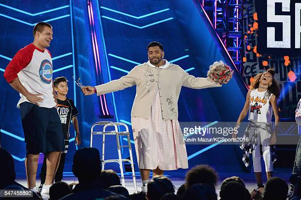NFL player Rob Gronkowski and host Russell Wilson speak onstage during the Nickelodeon Kids' Choice Sports Awards 2016 at UCLA's Pauley Pavilion on...