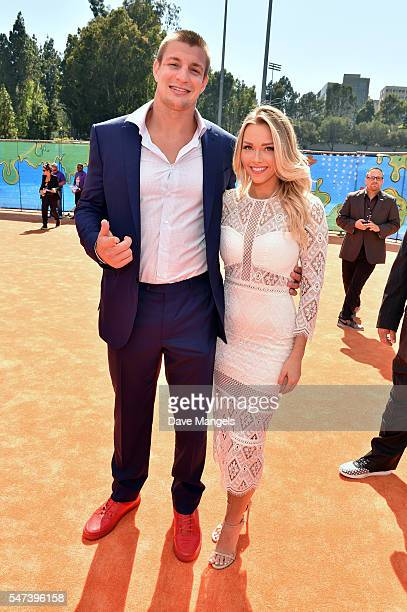 NFL player Rob Gronkowski and NFL cheerleader Camille Kostek attend the Nickelodeon Kids' Choice Sports Awards 2016 at UCLA's Pauley Pavilion on July...
