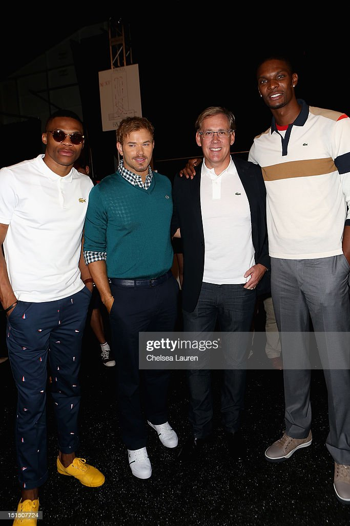 NBA player Russell Westbrook, actor Kellan Lutz, Lacoste CEO Steve Birkhold and NBA player Chris Bosh pose backstage at the Lacoste Spring 2013 fashion show during Mercedes-Benz Fashion Week at The Theatre, Lincoln Center on September 8, 2012 in New York City.