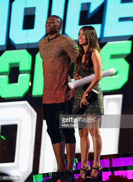 NBA player Russell Westbrook and actress Megan Fox speak onstage during Nickelodeon Kids' Choice Sports Awards 2014 at UCLA's Pauley Pavilion on July...