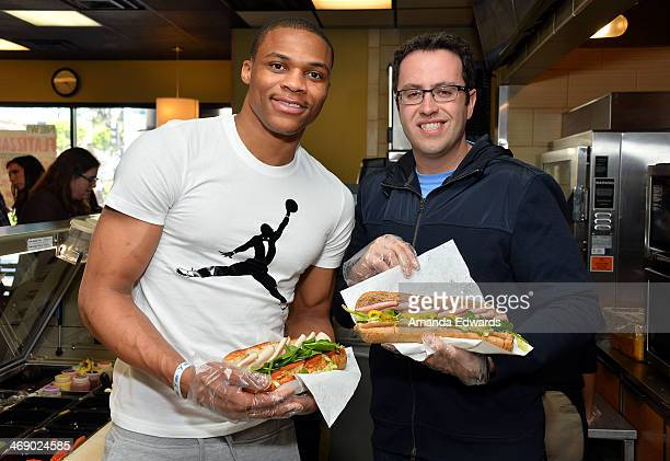 Player Russell Westbrook and Jared Fogle celebrate Westbrook's joining Subway's Famous Fan Roster at Subway Restaurant on February 12, 2014 in Los...
