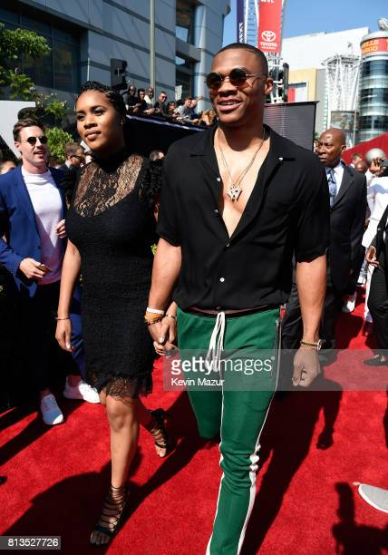 NBA player Russell Westbrook and Nina Earl attend The 2017 ESPYS at Microsoft Theater on July 12 2017 in Los Angeles California