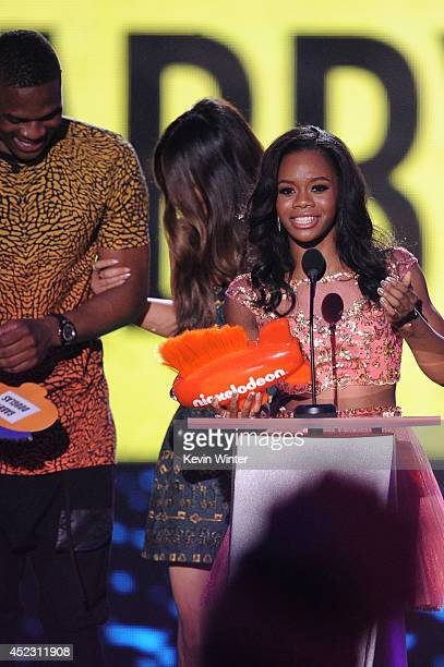 NBA player Russell Westbrook with Gymnast Gabby Douglas speaks onstage during Nickelodeon Kids' Choice Sports Awards 2014 at UCLA's Pauley Pavilion...