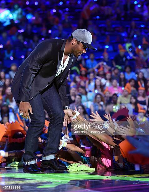 NFL player Russell Wilson accepts Favorite Newcomer Award onstage during Nickelodeon Kids' Choice Sports Awards 2014 at UCLA's Pauley Pavilion on...