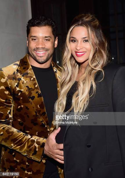 NFL player Russell Wilson and singer Ciara attend Vanity Fair and Genesis Celebrate Hidden Figures on February 24 2017 in Los Angeles California