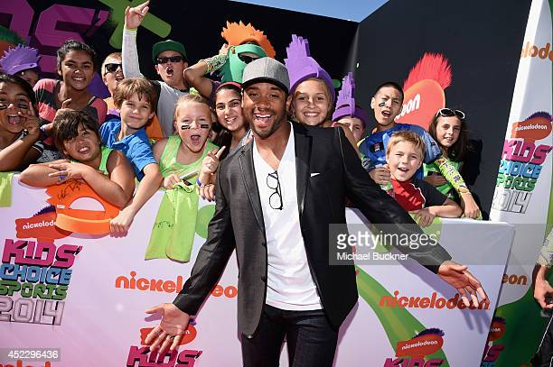 NFL player Russell Wilson attends Nickelodeon Kids' Choice Sports Awards 2014 at UCLA's Pauley Pavilion on July 17 2014 in Los Angeles California
