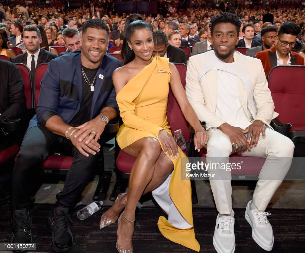 NFL player Russell Wilson music artist Ciara and actor Chadwick Boseman attend The 2018 ESPYS at Microsoft Theater on July 18 2018 in Los Angeles...