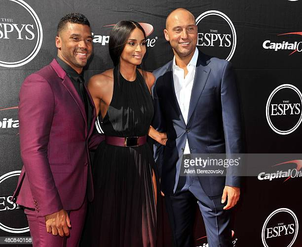 NFL player Russell Wilson recording artist Ciara and New York Yankee Derek Jeter arrive at the 2015 ESPYS at Microsoft Theater on July 15 2015 in Los...