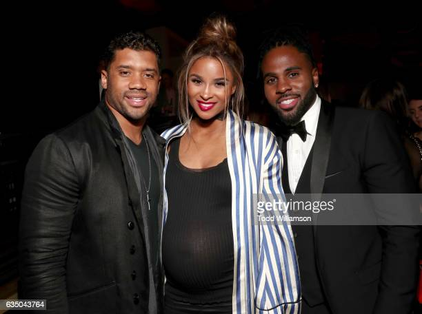 NFL player Russell Wilson singers Ciara and Jason Derulo attend the Warner Music Group GRAMMY Party at Milk Studios on February 12 2017 in Hollywood...