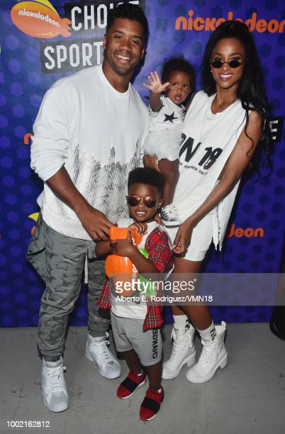 NFL player Russell Wilson winner of the Best Cannon award Future Zahir Wilburn Sienna Princess Wilson and Ciara pose backstage at the Nickelodeon...