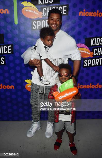 NFL player Russell Wilson winner of the Best Cannon award Sienna Princess Wilson and Future Zahir Wilburn pose backstage at the Nickelodeon Kids'...