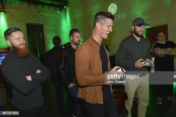 NHL player Ryan Ellis singersongwriters Curtis Rempel Brad Rempel of High Valley NHL player Nick Bonino test out new games at the Xbox Halloween...