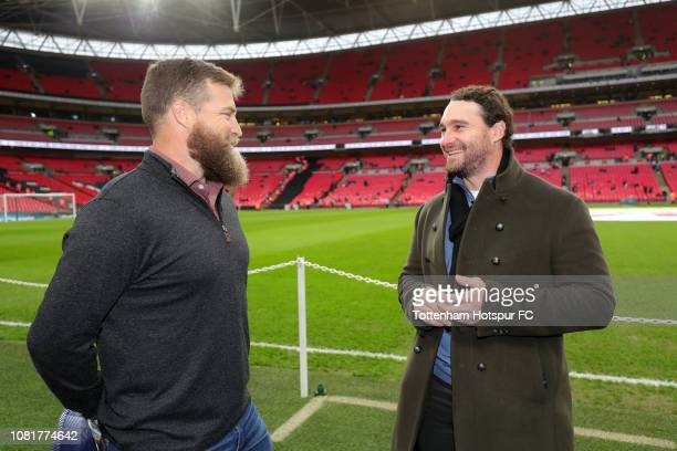 NFL player Ryan Fitzpatrick speaks to MLB player Daniel Murphy prior to the Premier League match between Tottenham Hotspur and Manchester United at...