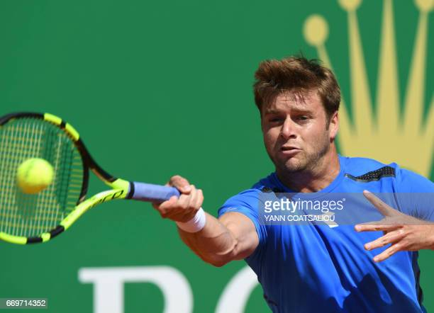 US player Ryan Harrison hits a return to France's Lucas Pouille during the MonteCarlo ATP Masters Series tennis tournament on April 18 2017 in Monaco...