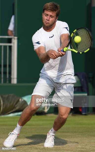 US player Ryan Harrison returns against Czech Republic's Tomas Berdych during their men's singles second round match on the fourth day of the 2017...