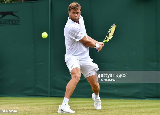 US player Ryan Harrison returns against France's Adrian Mannarino during their men's singles second round match on the third day of the 2018...
