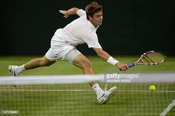 US player Ryan Harrison stretches to play a shot during his second round men's singles defeat to Serbia's Novak Djokovic on day three of the 2012...