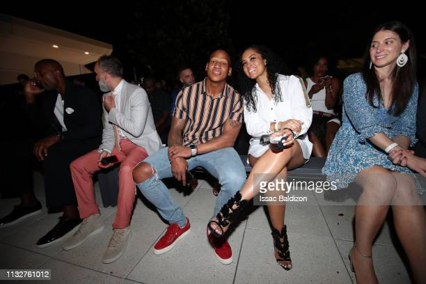 Player Ryan Shazier of the Pittsburg Steelers Michelle Rodriguez pose for a photo at the A Night On The RunWade event at Level Three on March 16 2019...
