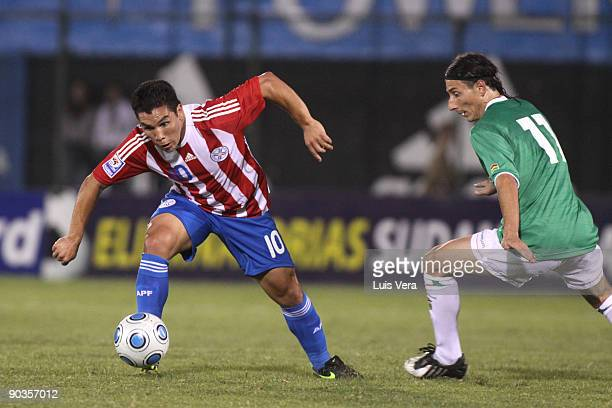 Player Salvador Cabanas of Paraguay vies for the ball with Pablo Escobar of Bolivia during FIFAWorld Cup South Africa-2010 qualifier at the...