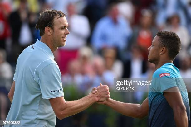 US player Sam Querrey and Britain's Jay Clarke shakes hands after Querrey's straight sets win in their first round men's singles match at the ATP...